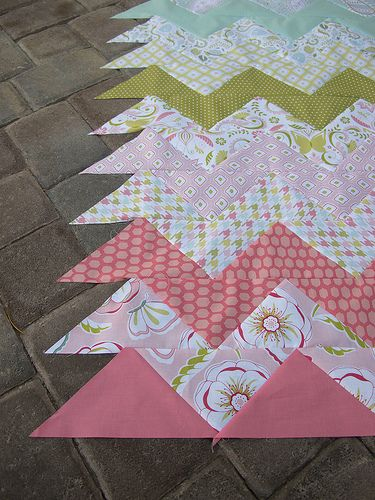 Easy way to do chevron quilt - and you can mix up fabric for a cute twist! Use triangles!