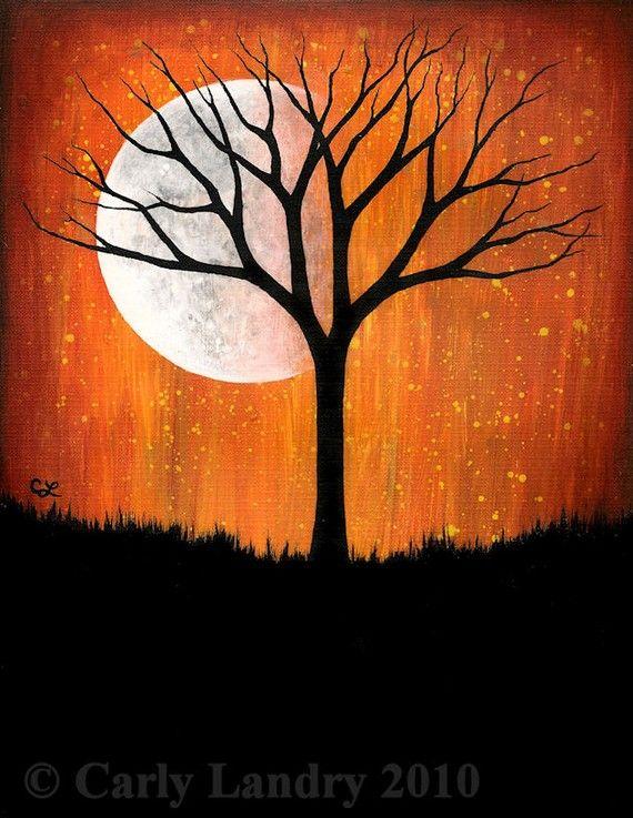 Dead tree with lifeless moon
