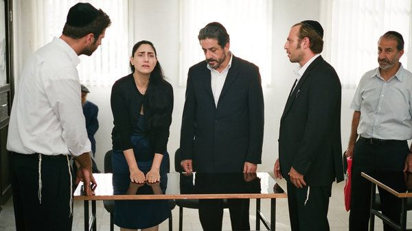 A new Israeli film playing in the U.S. shows how patriarchal Jewish divorce laws can trap even secular women for years. In Israel, if you're Jewish, even if you're not religious, you have to be divorced by Jewish law. The film is a drama called Gett: The trial of Viviane Ansalem. Viviane wants a divorce but needs her husband's permission. A Jewish man also needs his wife's permission to divorce, but without it he can live with another woman and have children recognized as Jewish in Israel…