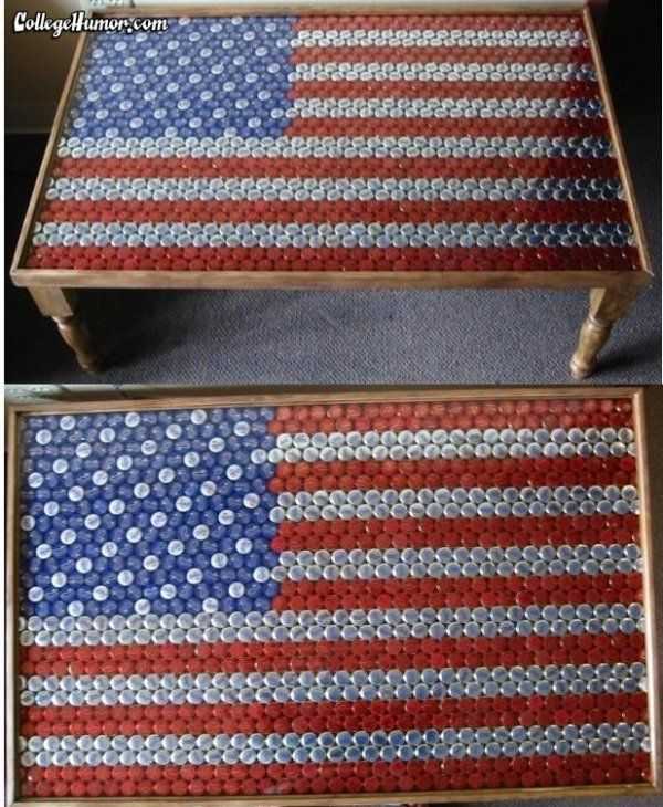 This is a table with 949 beer bottle caps on top of it.  389 Budweiser (red stripes), 346.5 Bud Light (white stripes), 163.5 Big Sky Brewing (blue), 50 Miller Lite (stars).  The caps are sealed under a clear resin to keep them permanent.