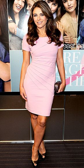 ELIZABETH HURLEY The star continues to support a cause close to her heart, wearing a figure-flattering dress in the shade of the month, plus gold peep-toe pumps to the Estee Lauder Companies Breast Cancer Awareness campaign launch in N.Y.C.