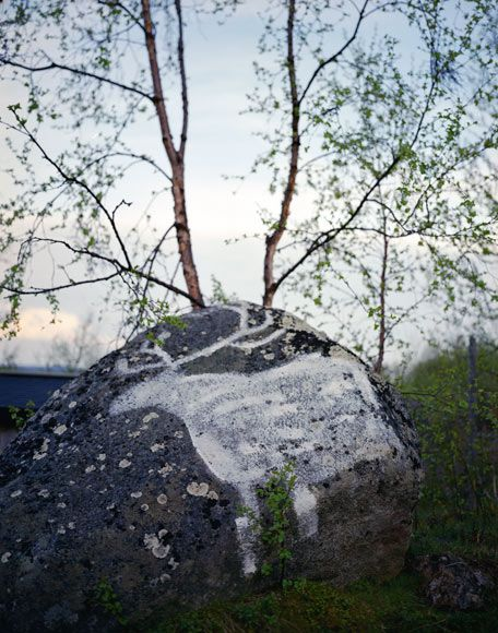 Photograph by Erika Larsen  //  A modern painting on a rock in Kautokeino, Norway, harks back to rock art from as early as 4200 B.C. created by people eking out an existence in northern Scandinavia.  //  national geographic article about the sami reindeer herders