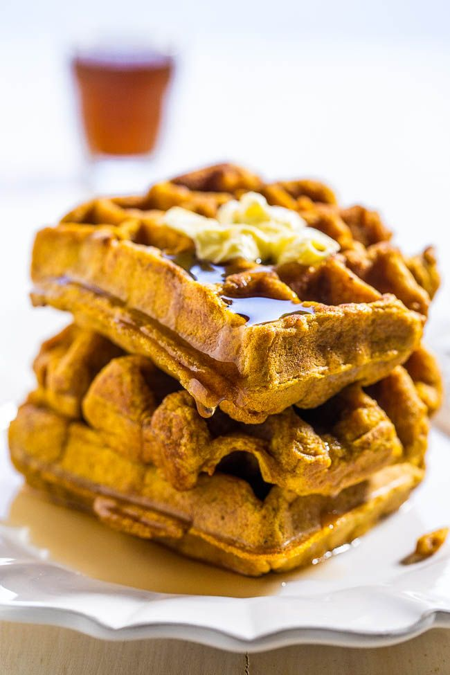 Pumpkin Waffles - Bold pumpkin flavor in every bite of these easy waffles!! Doused with maple syrup, they're a perfect comfort food breakfast that everyone will love!!