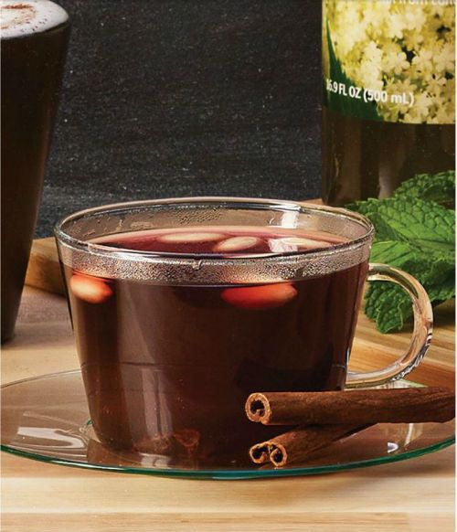 Classic Mulled Wine recipe from IKEA: 1 bottle of GLOGG ALKOHOLFRI non-alcoholic mulled red wine heated in saucepan on stove, A teaspoon or two of almonds and raisins, Cinnamon sticks for garnish