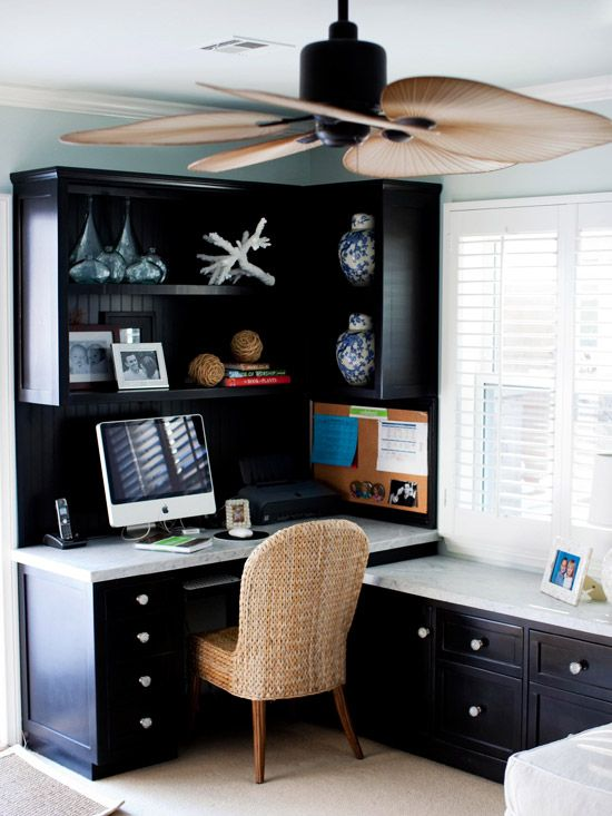 Corner Office  Tuck a home office into the corner of your family room or in a guest room for easy access with limited space. A wicker desk chair and a ceiling fan with blades that look like tropical leaves offer beach-inspired charm. Classic black cabinets are set off by a marble desktop. A cabinet under the window offers additional storage and an extra work surface to spread out large projects.: Guest Room, Corner Desks, Ceiling Fans, Offices Spaces, Black Cabinets, Corner Offices, Offices Ideas, Home Offices, Ceilings Fans