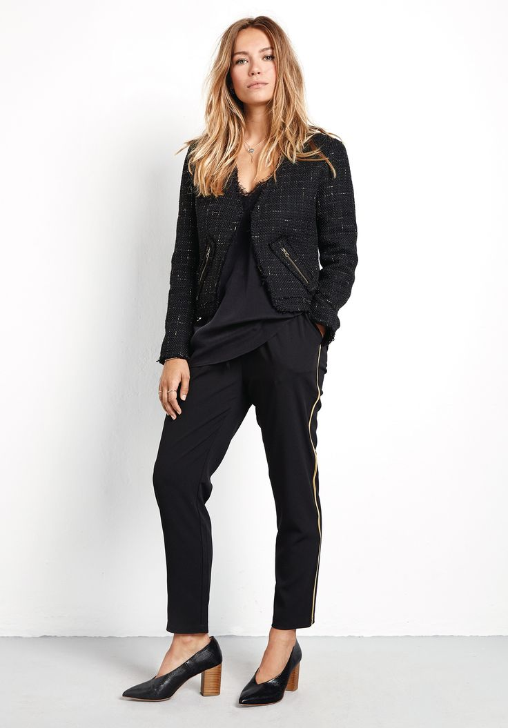 """Update you winter wardrobe with this ultra chic cropped jacket. In classic black with subtle gold flecks, pair with everything from smart dresses, to jeans and a tee. •Two zip pockets and frayed hems. •Semi-fitted, cropped style. Try your usual size. •Edge-to-edge open front. •Collarless with long sleeves. •Model is 5'7"""" and wears size 8."""