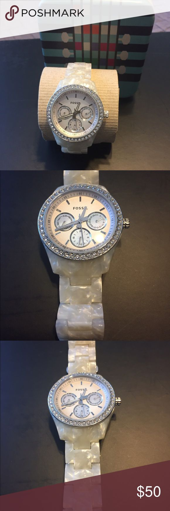 Fossil boyfriend watch Beautiful boyfriend fossil watch. The band looks like mother of pearl (I'm not certain if it is) and there is a patent number. This watch has only been worn a couple times. It is in excellent condition only needs a new battery. Comes with original box. Fossil Accessories Watches
