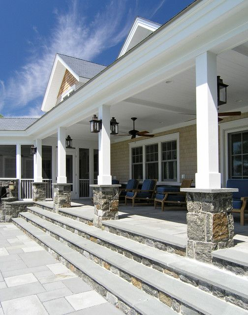 Front porch stone and wood pillars, new house idea: back porch leading to open patio.