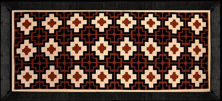 RAYUELA: This hand woven rug in burlap with leather borders (10 cm.) was inspired by Pre-Colombian stamps. Made by Gogó Anhalzer.