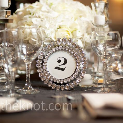 simple table numbers were displayed in round crystal studded frames