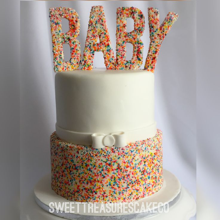 #babyshower #cake covered with #sprinkles to welcome #LindsayBaby.  Inside is #vanilla and #chocolate with #whitechocolate #ganache. #baby #itsagirl #100sand1000s #colour #sweettreasures #sweettreasurescakeco #johannesburg #joburg