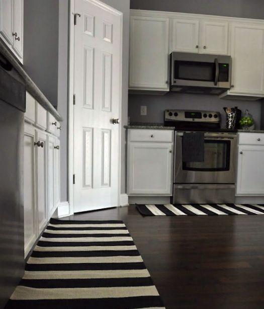 I love the wall color and the rugs!!Grey Walls, Hardwood Floors, Dark Wood Floors, Dreams House, Dark Floors White Cabinets, Organic Kitchens, Dark Hardwood, Gray Wall, White Kitchens
