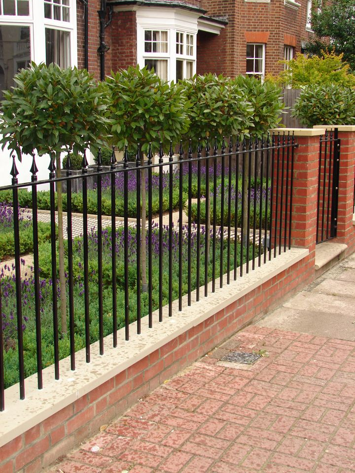 Front Garden With Railings   With Bay Lollipops And Lavender Underplanting.
