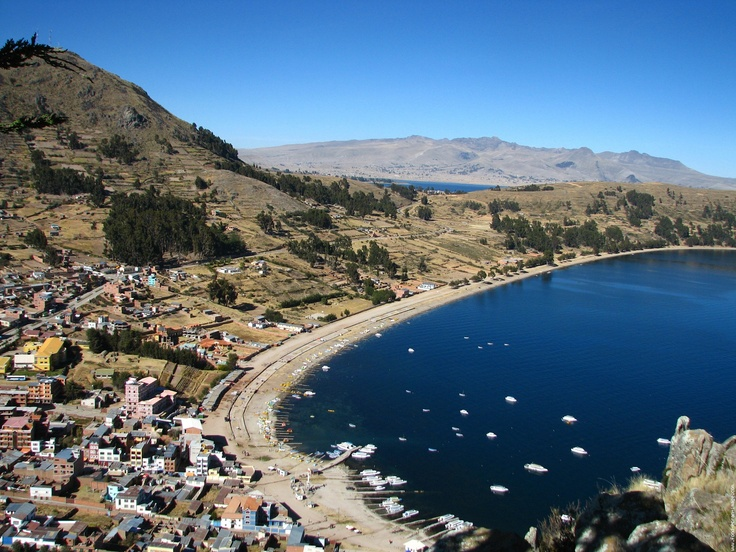 Lake Titicaca, Copacabana, Bolivia I love this place ...peaceful .. I went to this lake in 1996 it was so amazing ... This lake is 50 miles wide !!! And 115 miles long in top of the mountains!!!