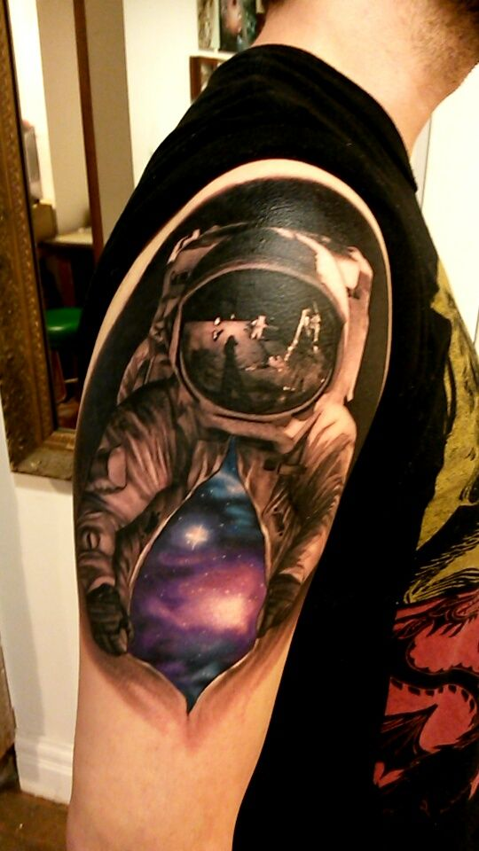 Astronaut galaxy tattoo, cool mix of color and b&g.