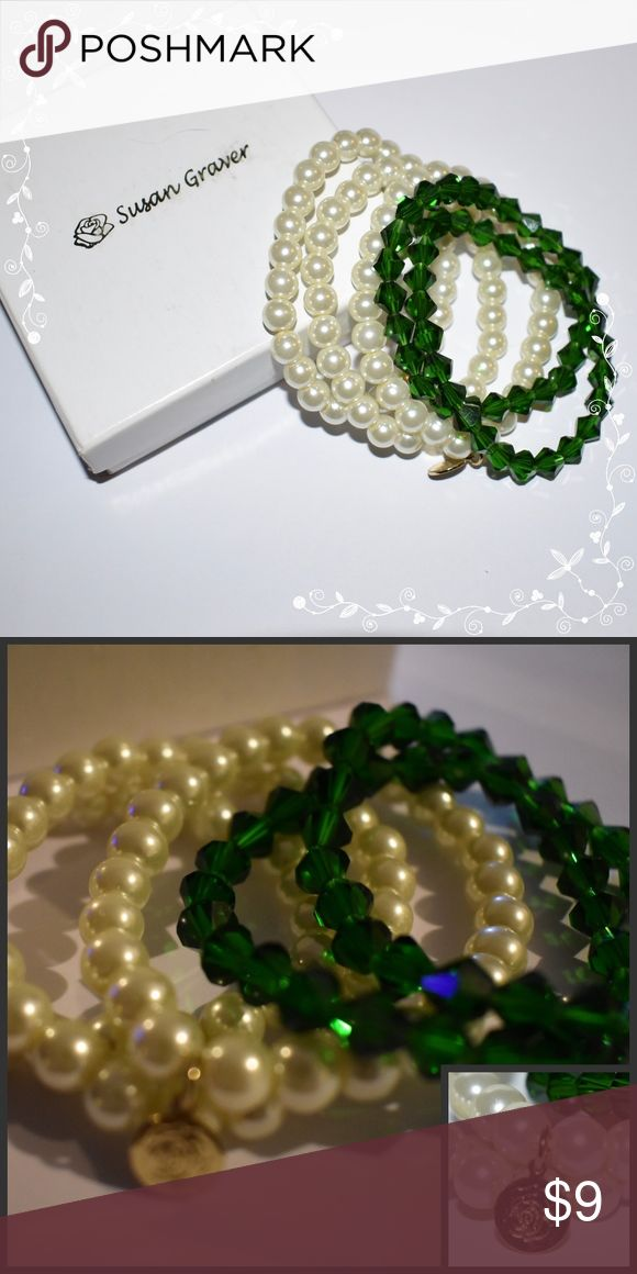Susan Graver 5pc Bracelet Set White & Green Beads Susan Graver 5pc Stretch Bracelet Set (3 white, 2 green)  Comes in Susan Graver gift Box  ATTENTION:  I have two of these sets.  One is missing the flower hallmark and one is not.   THIS LISTING IS FOR THE SET WITHOUT AND IS BEING OFFERED FOR A $1 LESS THAN THE ONE THAT HAS THE FLOWER.  The price is firm for this item.  For additional savings add to a bund to save on a pre-established percentage off and combined shipping. Susan Graver Jewelry…