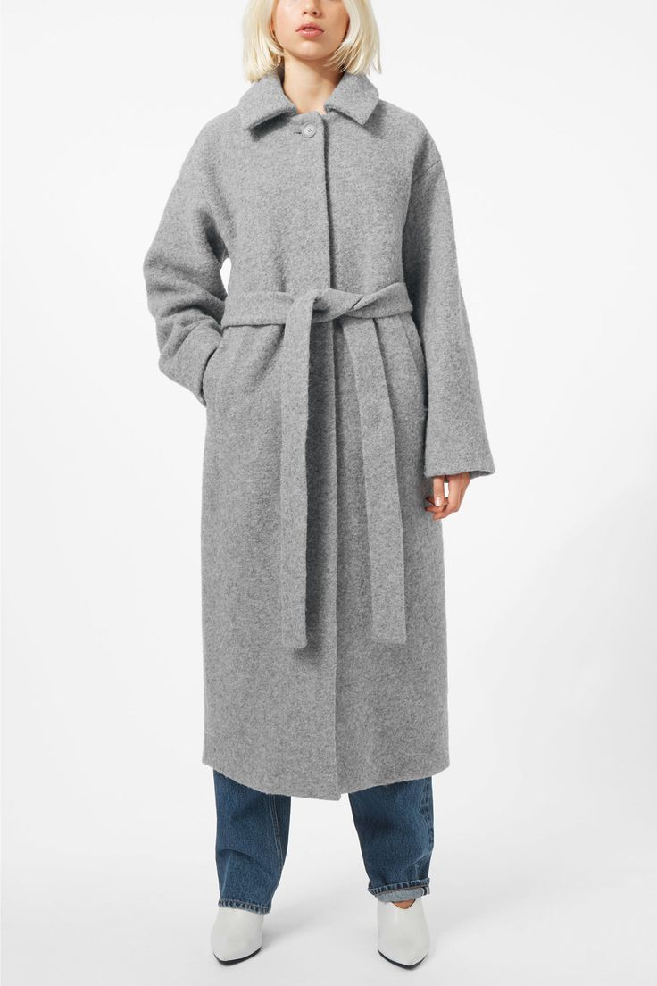 The Vendela Coat keeps the cold away in the chilly months. This classic long coat made from a warm wool blend has a wide-spread collar, a concealed button