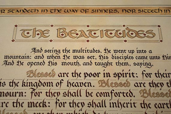 Matthew 5:1-12 is lettered in the Fraktur style, beginning with black ink and transitioning to red by the last verses. The words Blessed and Rejoice are highlighted in gold. These verses are surrounded by the blessing pronounced in Psalm 1:1-3 to the one who meditates on Gods