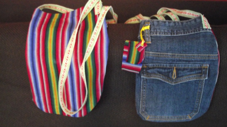 Bags made out of Estonian look-a-like folk costume materials, recycled jeans and some ribbons. (same bag, both sides)  @http://www.facebook.com/Kansanomaisetkankaat