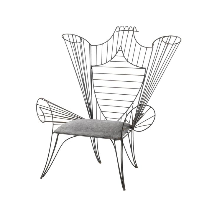 ANDRÉ DUBREUIL `TRÔNE'. A WROUGHT IRON CHAIR bent and welded, the shield back rising to an exaggerated scroll, slubbed fabric seat 144cm. high by 129cm. wide by 90cm. deep; 4ft 8¾in., 4ft 2¾in., 2ft 11½in. circa 1985