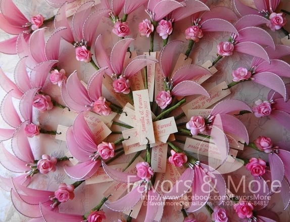Jordan Almond holders   organza wedding Favors done in tones of pink for a wedding hosted in UK.  -for details email favorsmore@gmail.com-