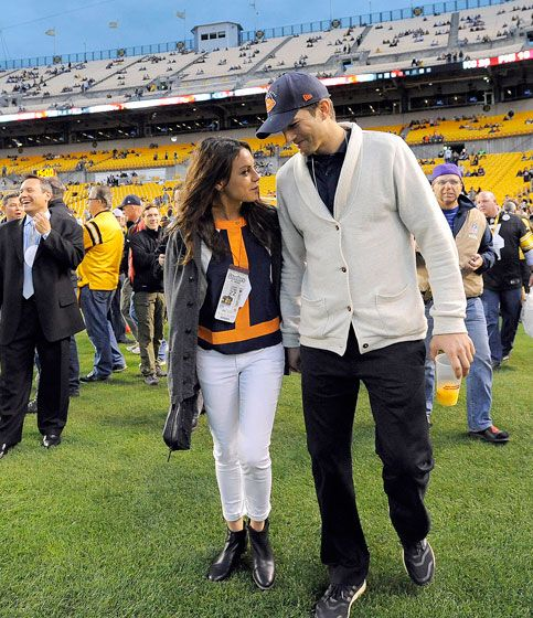 Football fans Mila Kunis held hands with Ashton Kutcher at Heinz Field in Pittsburgh before the Chicago Bears faced off against the Steelers Sept. 22.