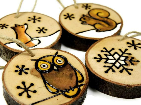 I wood burned these woodland animal ornaments by hand on slices of dogwood branch. I then filled in the design with professional quality