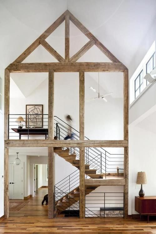 I imagine decorating for Christmas. I would wrap the staircase in twinkle lights, and wrap branches of evergreens around the exposed beams. Then at the crosshatch (thinger) I would hang a giant wreath.