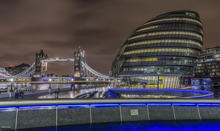 Tower Bridge and City Hall, London - City Hall is part of the More London development located between London Bridge and Tower Bridge, on the south bank of the Thames. It was designed by Foster + Partners, one of Britain's leading architects.  Every element of the building is designed to work alongside every other element, to keep the building cool or warm in an environmentally friendly way.