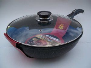Ceramic Marble Coated Non Stick Cast Aluminium Wok with Lid, 26 cm (10 inches) by California KitchenWare. $30.90. Premium Quality Cast Aluminium with 4 layers of Non-Stick Marble Coating. Marble coating both inside and outside, 10x stronger than teflon coating. Tempered Glass Lid. Ceramic Marble Coated Wok with Lid. Made in Korea...leader in new ceramic non stick technology. This is the best non-stick wok. Made of premium quality cast aluminium and coated with 4 lay...