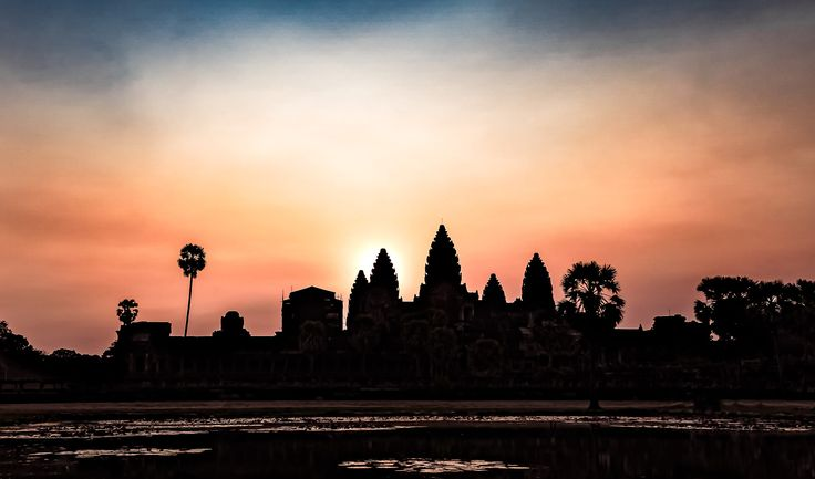 "Angkor Wat (Khmer: អង្គរវត្ត or ""Capital Temple"") is a temple complex in Cambodia and the largest religious monument in the world, with the site measuring 402 acres). It was originally constructed as a Hindu temple of god Vishnu for the Khmer Empire, gradually transforming into a Buddhist temple towards the end of the 12th century.  It was built by the Khmer King Suryavarman II in the early 12th century in Yaśodharapura the capital of the Khmer Empire, as his state temple and eventu..."