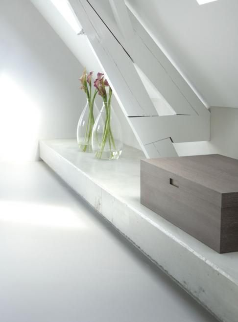 Remy Meijers, always good for clean design. A simple bench under the eaves, yet items placed on here get more flair than simply placed on the floor. Plus this can hide pipes etc.