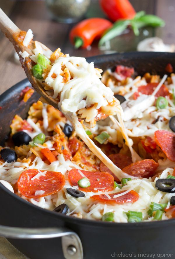 A delicious pizza pasta all made in one pot and topped with your choice of pizza toppings. This dinner comes together in less than 20 minute...