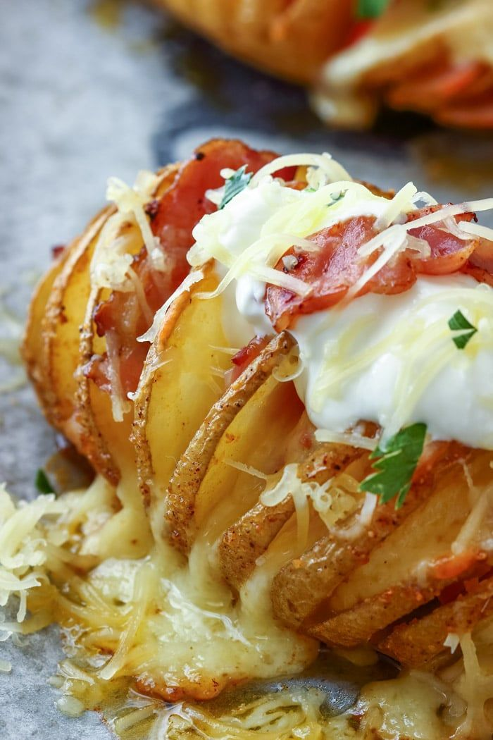 Loaded Hasselback Potatoes ~ Loaded Baked potatoes stuffed with cheese and bacon will be a hit at your dinner table. Top them with sour cream and enjoy while warm! ~ https://www.julieseatsandtreats.com