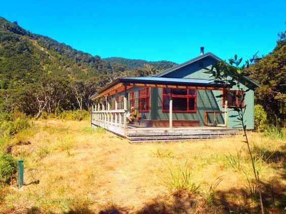 Totara Flats Hut on the popular Kaitoke - Holdsworth track, Wairarapa, New Zealand. Photo: Don Herron #dochuts