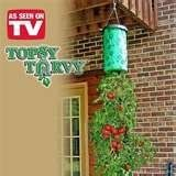 "Topsy Turvy Tomato Tree Hanger by Allstar. $2.95. TOPSY TURVY UPSIDE DOWN ""TOMATO PLANTER,"" AS SEEN ON TV, USES GRAVITY AS A VERTICAL GROWING ADVANTAGE, VERTICAL GROW BAG HEATS THE PLANT LIKE A GREENHOUSE, SO ROOT SYSTEMS EXPLODE, GRAVITY PULLS THE WATER AND NUTRIENTS DIRECTLY TO THE ROOTS - #PLANT IN BOTTOM#SOIL IN BAG#WATER IN TOP (PLANTS NOT INCLUDED)CAN GROW GREEN PEPPERS, ZUCCINI,CUKES,EGGPLANTS,AND MORE"