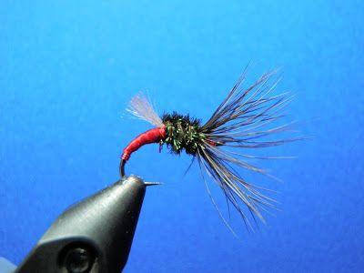 Photo by Karel Lansky Royal Coachman Sakasa Kebari Hook: caddis hook, size 12 Body: red floss, Ultra Thread or similar Collar: peacock her...
