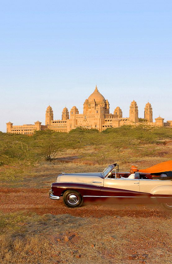The Umaid Bhavan Palace and hotel in the background. One of the royal automobiles in the foreground. The erstwhile maharaja and his family still reside here. Jodhpur, Rajasthan. incredible india!