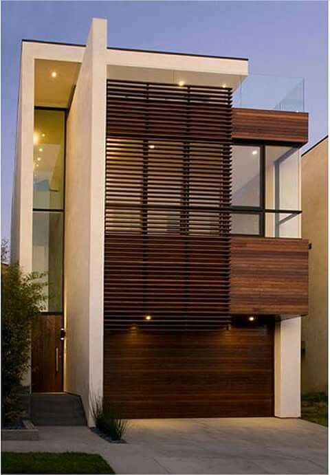 Fachada que combina concreto, madeira e vidro!                                                                                                                                                                                 Mais