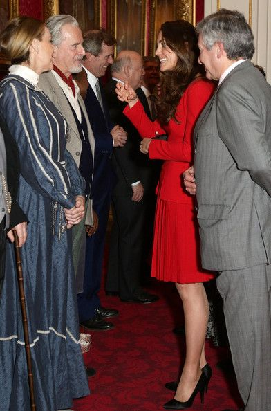 Catherine, Duchess of Cambridge meets performers, including Trevor Eve during the Dramatic Arts reception at Buckingham Palace on February 17, 2014 in London, England.