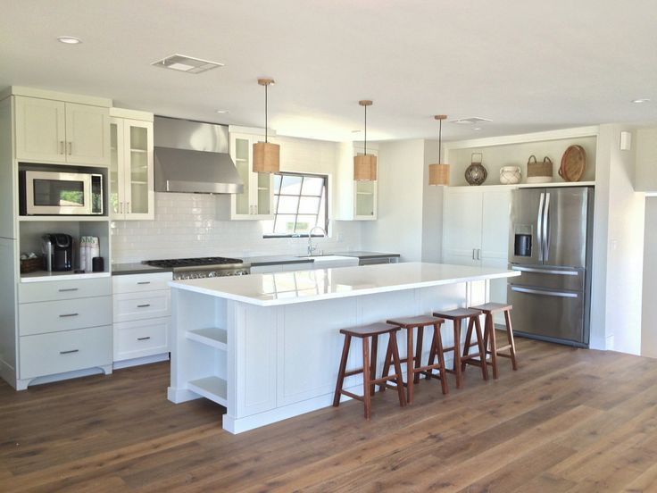 Great Room Kitchen Open Concept With Large Island White Shaker Cabinets And Marble