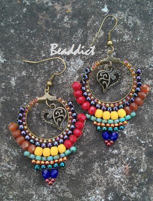 Brick stitch earrings Designed and beaded by Beaddict. Seed beads fire polished beads.