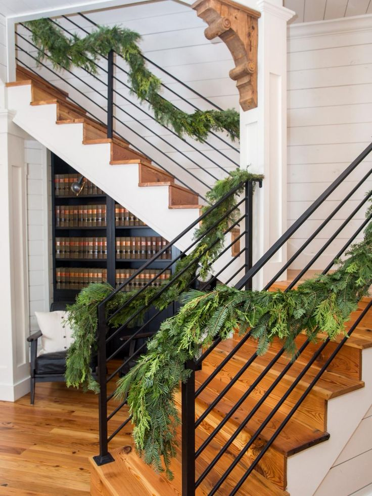 The updated stairs are widened and have a sleek look with hardwood and a new iron railing.
