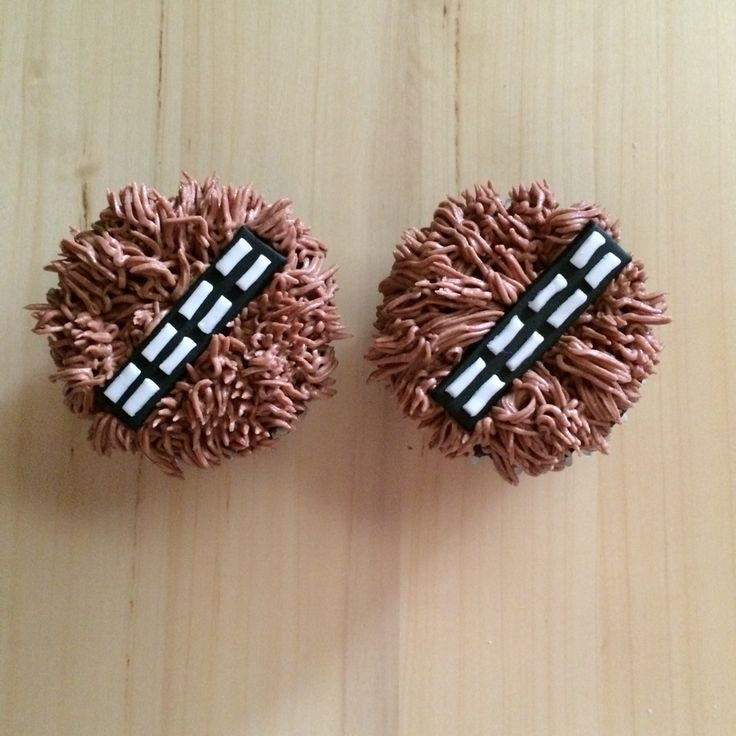 Star Wars Chewbacca cupcake toppers. Buttercream with a grass tip to make the fur and black and white fondant to create the strap.