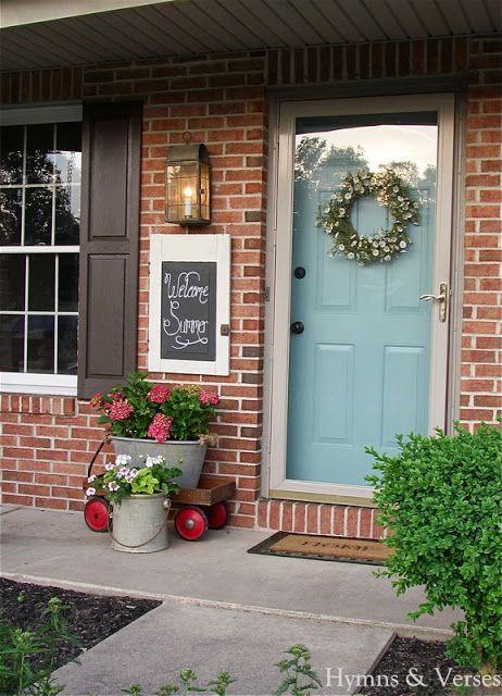 Brick wall + light blue door + grayish trim + storm door. via Debbiedoo's.