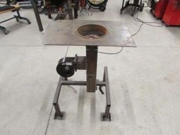 Brake Drum Forge - Homemade coal-fired forge constructed from a surplus brake drum, steel channel, and square tubing.