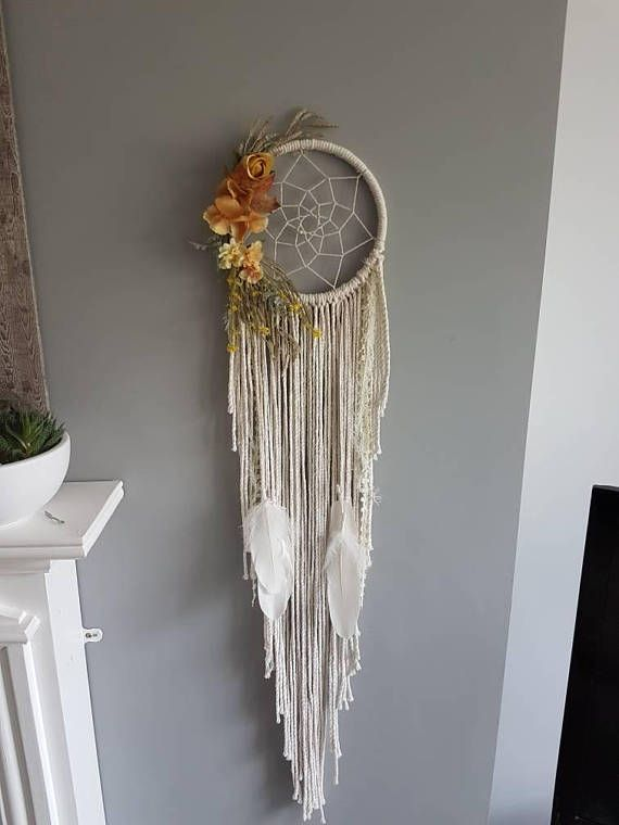 Autumn floral dreamcatcher. This beautiful wall hanging is made with beige string and cream feathers, yellow and orange florals attached for that autumn feel and intricate webbed detail, ready to give you that perfect dreamy night sleep. Size approx 8inch #afflink