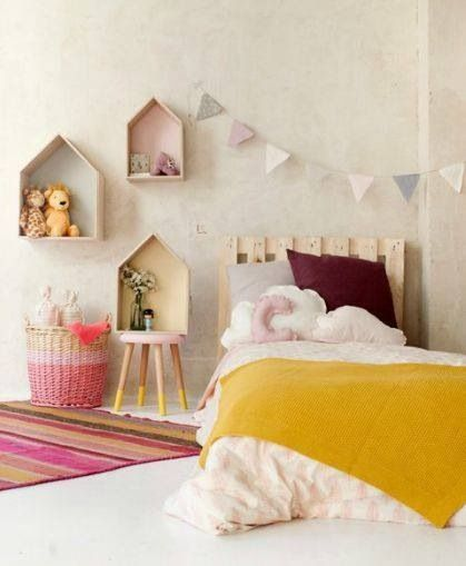 Beautiful girls room with bunting and shelves