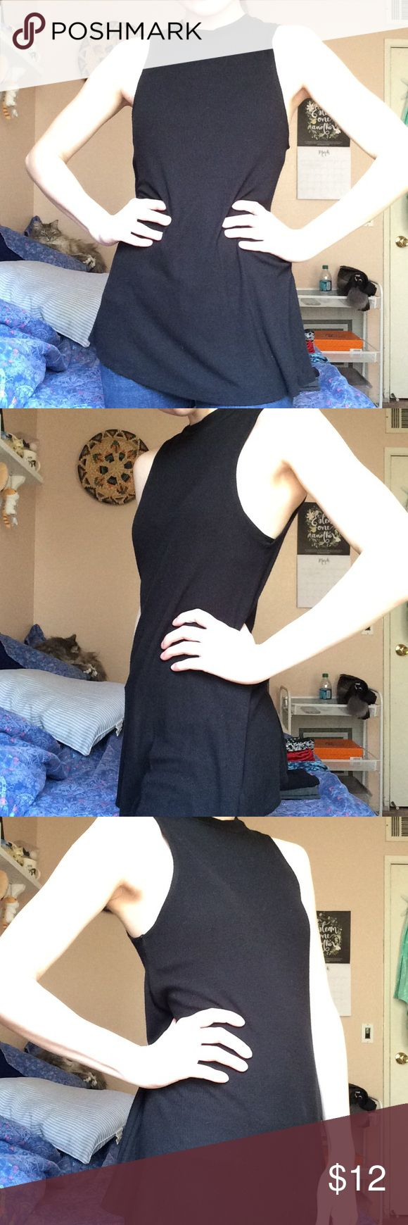Long Black Sleeveless Turtleneck Top Worn a few times and is in perfect condition. Looks great with blue jeans or patterned leggings. Brand is Mossimo. Mossimo Supply Co Tops Tunics