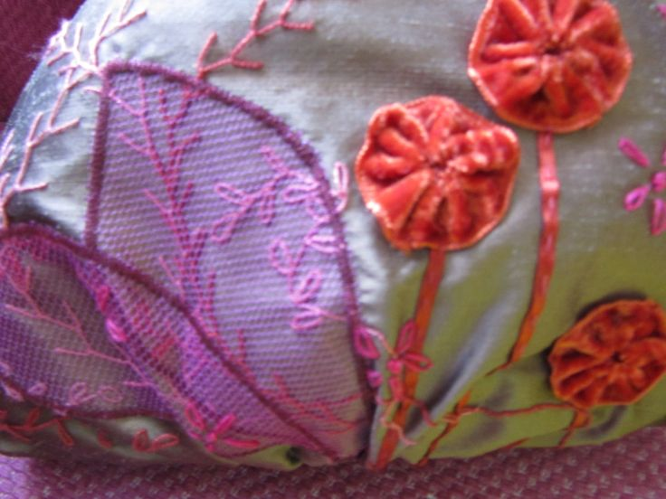 Pale brown silk bag with orange and purple flower motif stitched with hand and machine embroidery.